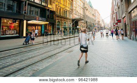 View of Kluuvikatu street, HELSINKI, FINLAND. People walk down s