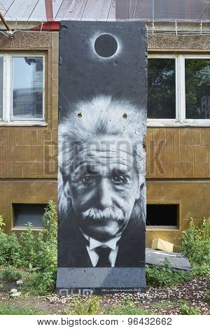 BERLIN, GERMANY - JULY 07: Segment of Berlin Wall in East Berlin with Albert Einstein portrait painted on. July 07, 2015 in Berlin.