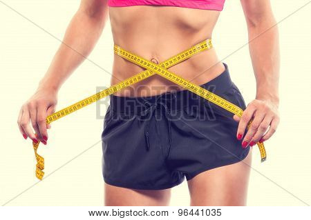 Weight losing - measuring woman's body, isolated centimeter poster