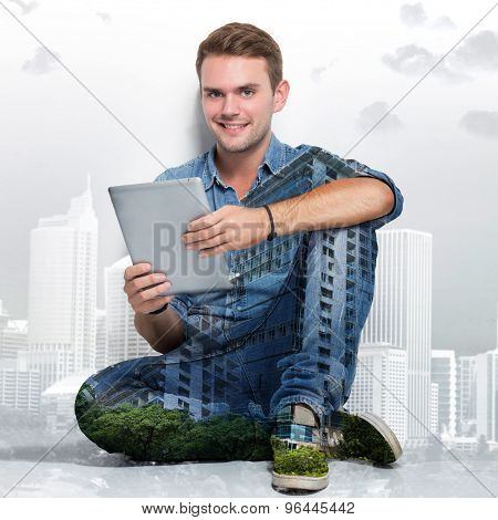 Young Caucasian Man Sitting On The Floor Holding A Tablet Pc. Multi Exposure Photo
