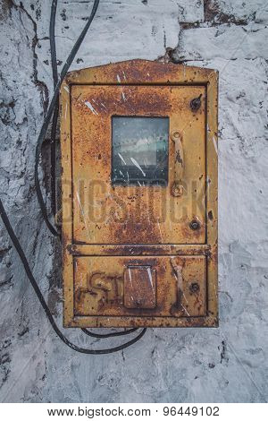 JODHPUR, INDIA - 09 FEBRUARY 2015: Old fusebox on white stone wall. Post-processed with grain, texture and colour effect.
