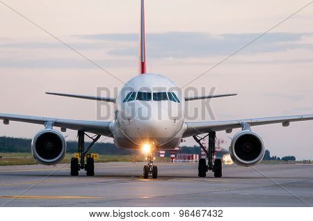 Airplane ready to take off from runway. A big passenger or cargo aircraft, airline. Transport, trans