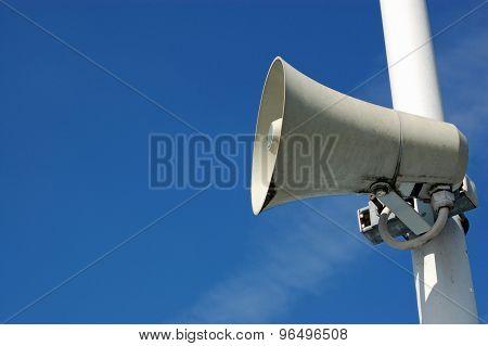 Speaker Against A Blue Sky