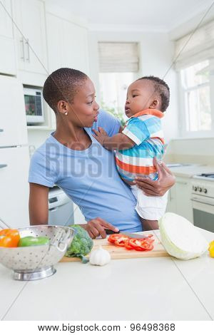 Happy mother with his babyboy in the kitchen