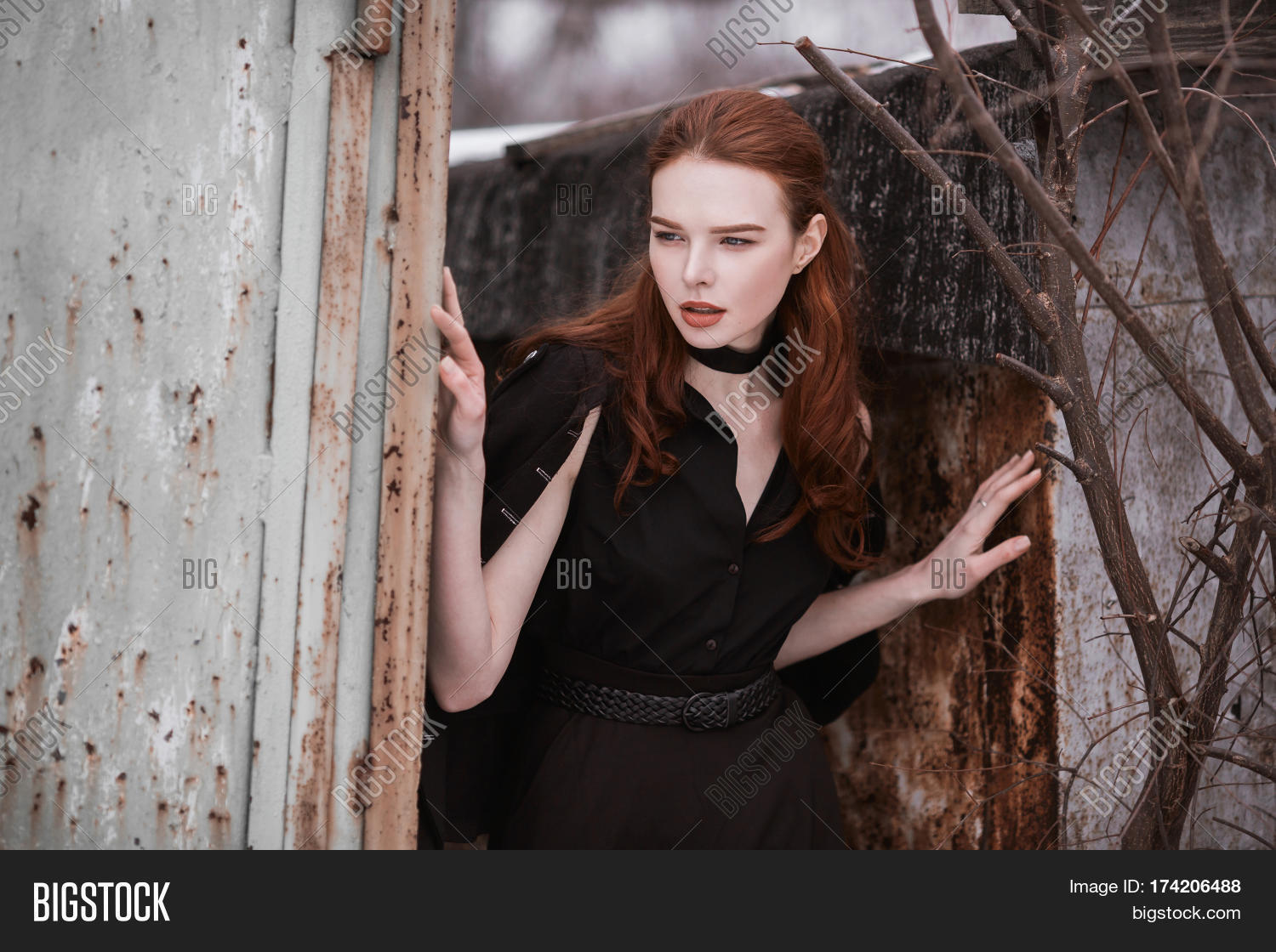 Striking Gothic Girl With Long Red Hair In Black Clothes A Woman