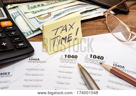 Tax time concept with 1040 tax document and money