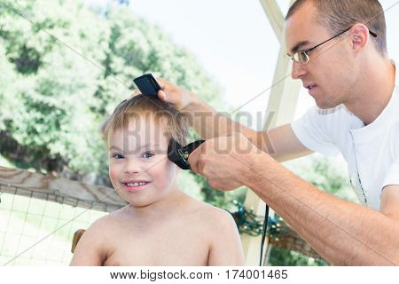 Cute Little Boy With Downs Syndrome Getting His Haircut