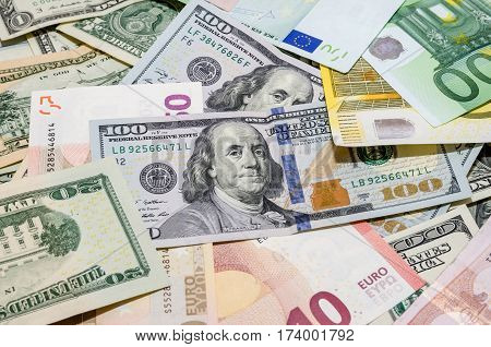 Pile Of Two Leading Currencies - Us Dollar Versus Euro As Background