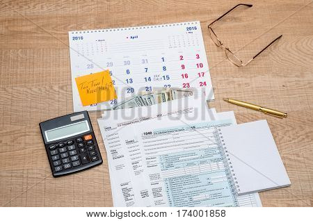 Tax Form With Calendar, Pen, Calculator, Notepad And Glasses