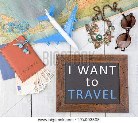 Blank Blackboard, Plane, Map, Passport, Money, Sunglasses On White Wooden Table