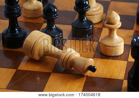 Chess white king gives up on chessboard
