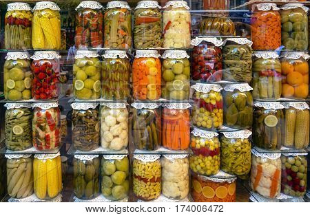Tursu Turkish pickled vegetables and fruits neatly arranged in jars in a market in Istanbul Turkey