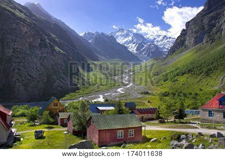 Green Valley Caucasus Mountains. The ice-capped mountains. village in the mountains.