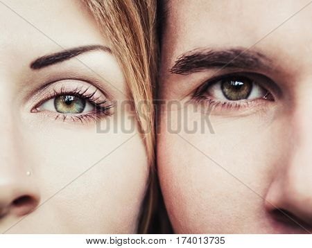 Close-up of eyes of a young loving couple. Romantic concept. Green and brown eyes