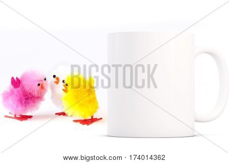 Easter Mug Mockup. Coffee mug mockup next to yellow fluffy toy easter chicks. Perfect for Easter mugs.