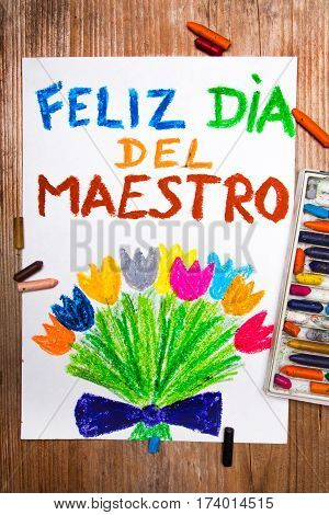 Colorful drawing - Spanish Teacher's Day card with words: Día del maestro - Happy teachers day