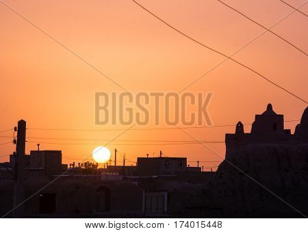 beautiful sunset over Ghoortan citadel by village near Varzaneh in Iran