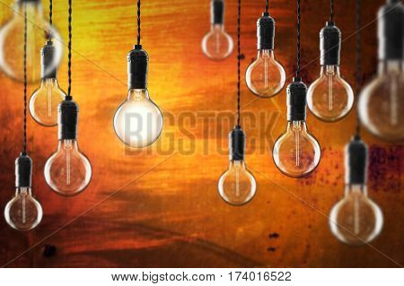Idea And Leadership Concept Vintage Incandescent Edison Bulbs On Color Background