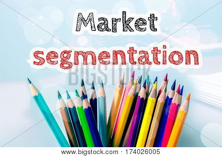 Market segmentation, text message on blue background with color pencil