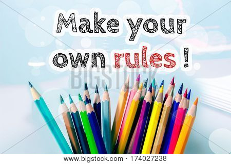 Make your own rules, text message on blue background with color pencil