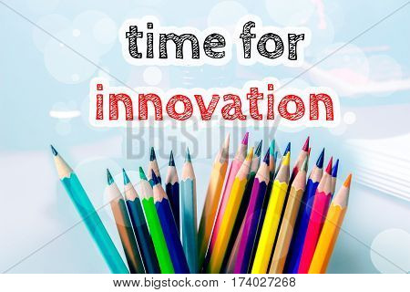 Time for innovation, text message on blue background with color pencil