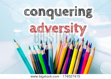 Conquering adversity, text message on blue background with color pencil