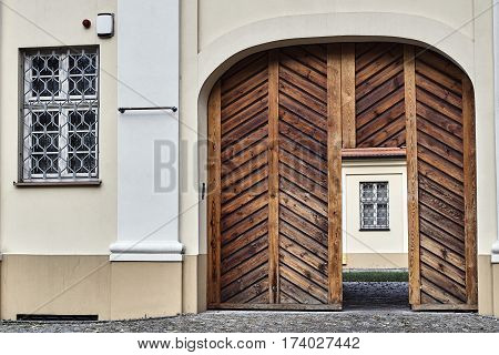 Wooden doors and barred windows in a historic building in Gniezno