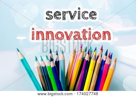 Service innovation, text message on blue background with color pencil