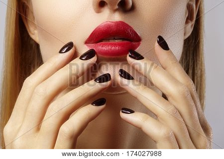 Close-up Of Woman's Lips With Fashion Red Make-up And Manicure. Beautiful Female Full Lips With Perf