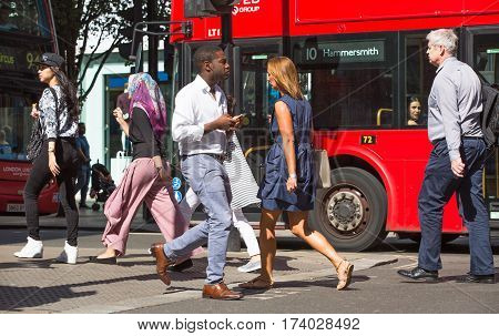 London, UK - 8 September, 2016: Lots of people walking in Oxford street, the main destination for shopping in West End London. Modern life concept