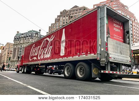New York February 28 2017: A Coca-Cola. truck has stopped on the red light on Amsterdam Avenue.