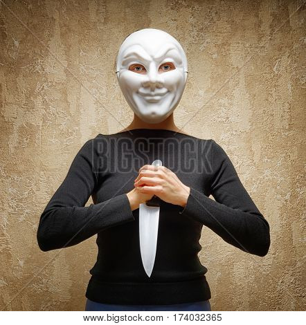 Woman In White Mask Holding The Knife