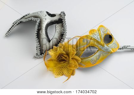 Two colorful carnival mask on white background.