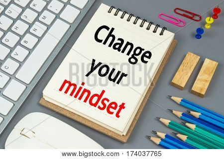 Change your mindset, Text message on white paper