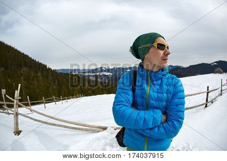 hiker with backpack on the trail in the Carpathians mountains at winter