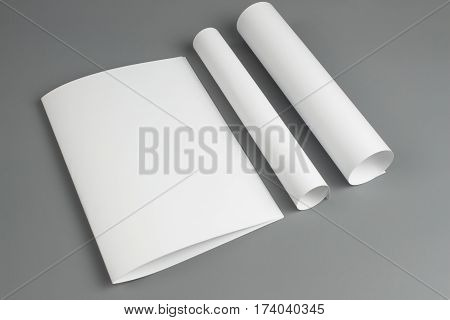 paper rolls Blank portrait A4. brochure magazine isolated on gray, changeable background / white paper isolated on gray