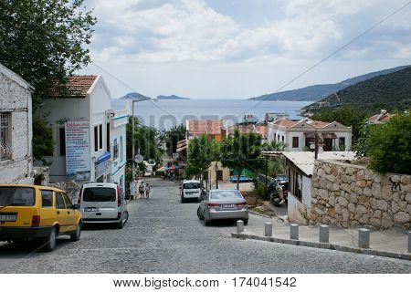 KALKAN, TURKEY - MAY 22 Narrow streets of Kalkan Town in Mediterranean Turkey descending to sea with stone houses and mountains on background IN 2016