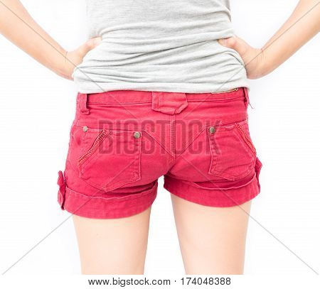 Closeup woman show red shorts and arms akimbo with white background