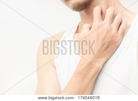 Closeup young man scratch the itch on neck with white background
