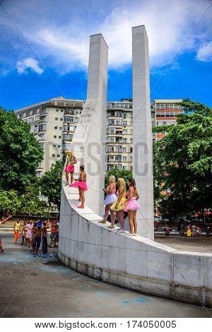 RIO DE JANEIRO, BRAZIL - FEBRUARY 28, 2017: Young women in bright tutu skirts standing at the Memorial Getulio Vargas of Praca Luis de Camoes, Gloria neighborhood at Carnaval 2017