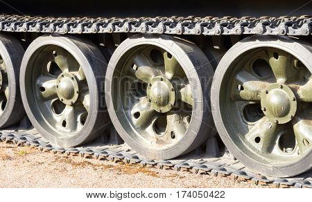 Tracks and wheels of old Soviet panzer in St.Petersburg Russia.