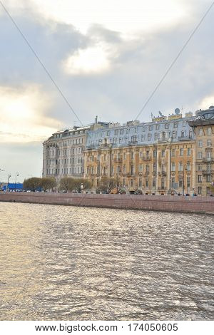 View of Neva River and Mytninskaya quay on Petrograd side in center of St.Petersburg at cloudy spring evening Russia.