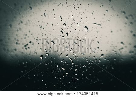 monochrome of rain on window with aspect of saddness