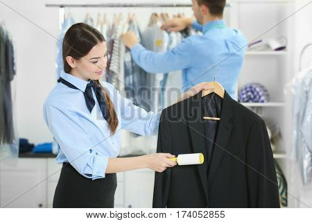 People working in dry-cleaning salon
