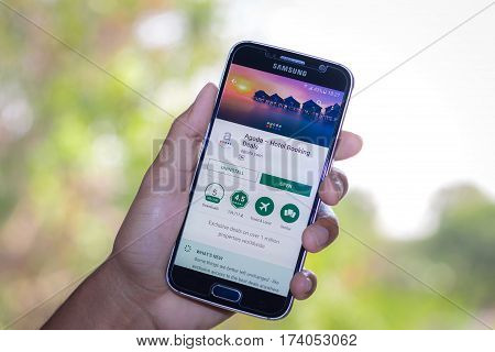 Chiang Mai,Thailand - March 2, 2017: Smartphone Samsung Galaxy S6 open apps agoda application on the screen on the desk.