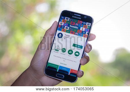 Chiang Mai,Thailand - March 2, 2017: Smartphone Samsung Galaxy S6 open apps tumblr application on the screen on the desk.