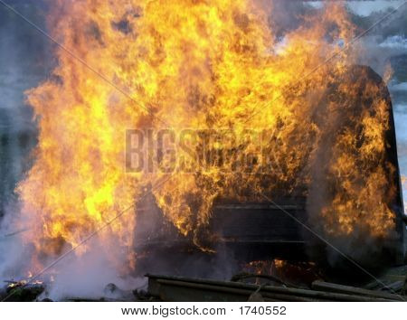 Flames Leaping From Wreck