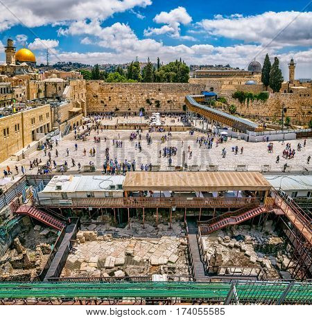 JERUSALEM, ISRAEL - MAY 23, 2016: Prayers making their wishes and prays at the Western Wall, Wailing Wall or Kotel witch is located in the Old City at the foot of the western side of the Temple Mount.