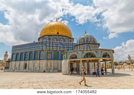 JERUSALEM, ISRAEL - MAY 23, 2016: Visitors sightseeing the Dome of the Rock, an Islamic shrine located on the Temple Mount in the Old City.