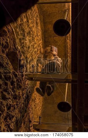 JERUSALEM, ISRAEL - MAY 23, 2016: Man praying in the tunnel at the closest physical point to the Holy of Holies at the Western Wall, foot of the western side of the Temple Mount.